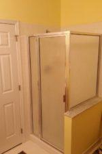 before updating the shower door
