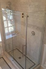 Bryn Mawr glass installs a frameless glass shower door