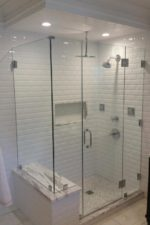 Glass Shower Enclosure Featuring White Tiled Walls