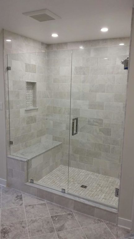 Shower with bench, frameless glass door by Bryn Mawr Glass