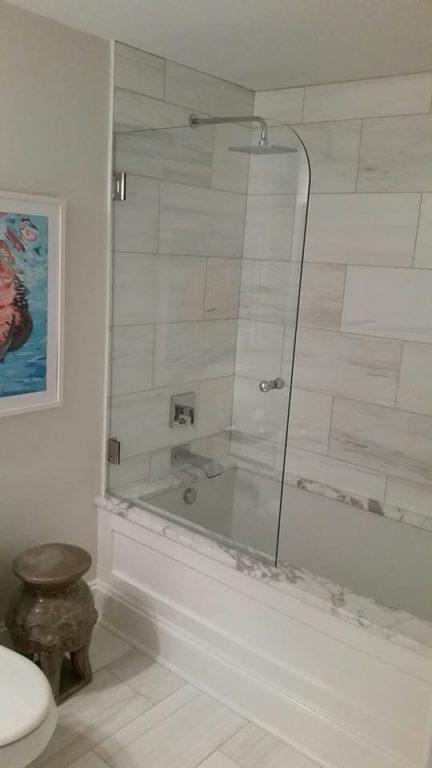 Frameless glass shower door on the main line