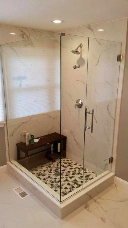 Frameless glass shower door with a wooden seat