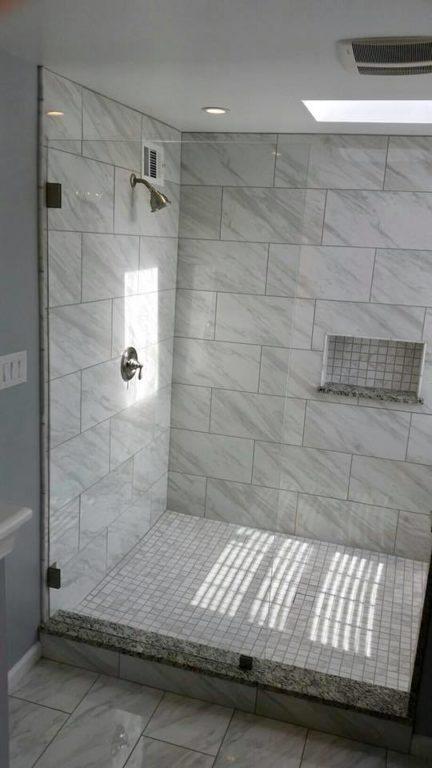 Frameless glass shower door with white tiles